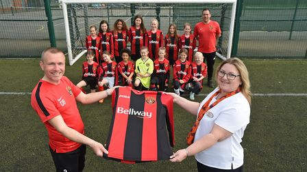 Bellways Heather Markham (right) with Cottenham Colts Under 12s team and their coaches, David Burket