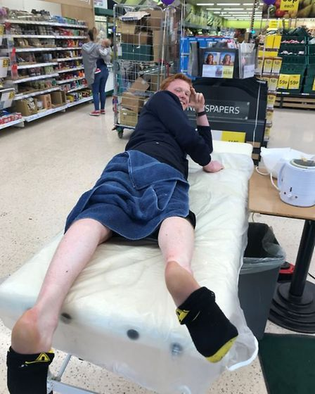 Tesco staff putting on a brave face as they get their legs waxed. Picture: CONTRIBUTED