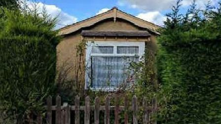 Asbestos ridden, says developer, of the derelict bungalow they want to remove for more homes on the