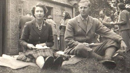 Previously unseen snaps of the Queen and Prince Philip (pictured) relaxing with famous author Daphne