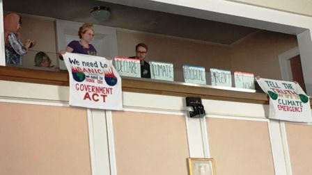 Climate change protestors inside Shire Hall on Tuesday during the debate led by Cllr Steve Count. Pi