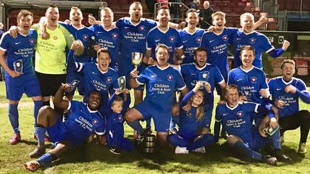Whittlesey Athletic celebrate their Cliff Bullen Challenge Cup success. Picture: DAN MASON
