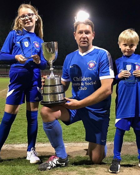 Whittlesey Athletic player-manager Ricky Hailstone shows off the Cliff Bullen Challenge Cup with chi