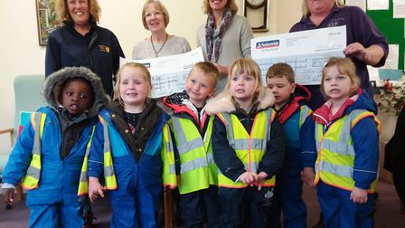 RDA Members and children of Sutton Butterfly Pre-school with their cheques. Picture: HELLEN @ NELLI