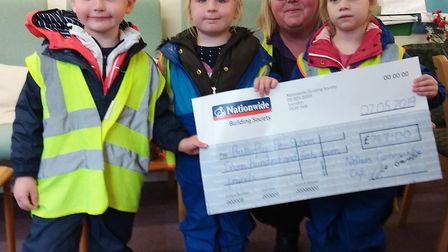 Community Cafe in Sutton presented nearly £2000 to two worthy causes. Butterfly Pre-school Manager D