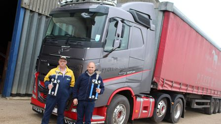 Chris and John Sallis with the Volvo FH N111HFF - P J Lee & Sons, Ely. Truckfest 2019. Picture; GARY