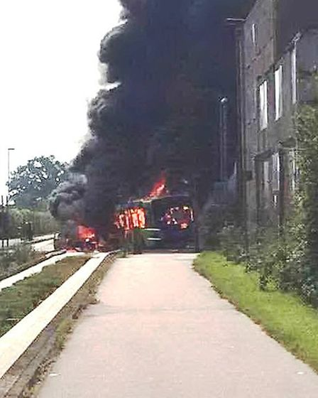 Guided busway fire: Fire swept through a bus and a car on the guided busway in Cambridgeshire today.
