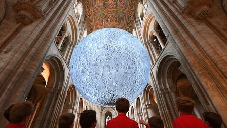 Choristers view Luke Jerram's 'Museum of the Moon' installation at Ely Cathedral in Cambridgeshire.