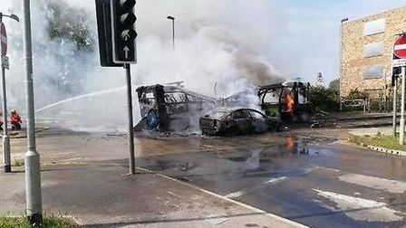 Cambs Fire have released these photos of the aftermath of a collision between a car and guided bus t
