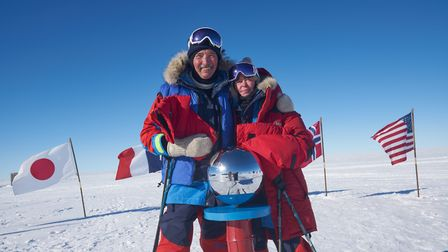 Graham and Susan Tobbell celebrating once they reach the South Pole, Picture: Rune Gjeldnes
