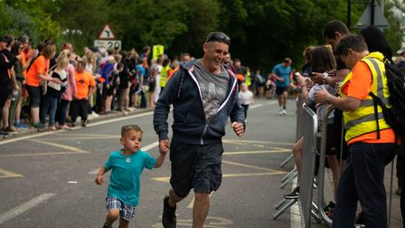 Parents and children had fun during the one-mile fun run. Picture: IAN MCLEOD