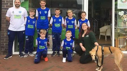 Parents of Witchford Colts under 11s blue team fundraised for a new training top while helping a loc
