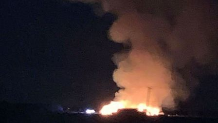 Crews remain at the scene of a stack fire involving 2,000 tonnes of bailed straw in Mepal. They were