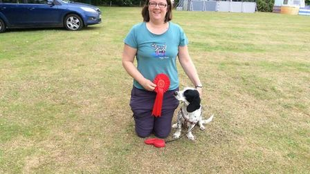 Natasha Sargeant with her dog Lily, who won a first place rosette for agility at the Coldham Dog Sho