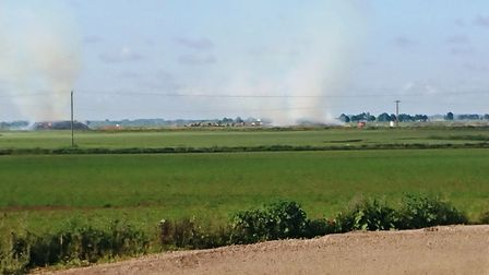 Fire crews are at the scene of two straw stacks fires near the former Mepal Outdoor Centre off the A