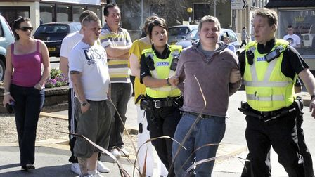 Nigel Marsh is led away by police in 2011. He was later to receiove £25,000 compensation from Cambri