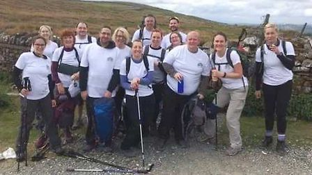 Twenty climbers from Whittlesey scaled three mountains in a bid to raise as much charity cash as the