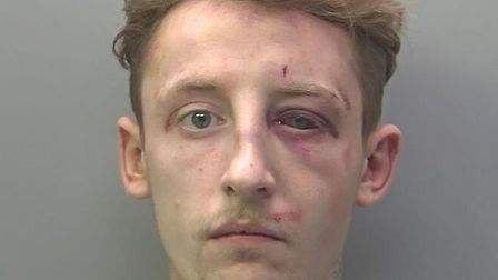 Kieran Graham (pictured) has been jailed after biting and spitting at police officers before serious