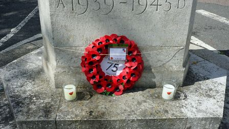 A wreath and candles laid at the Dunmow war memorial to mark 75 years since D-Day. Picture: CONTRIBU
