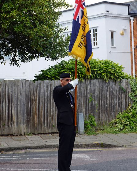 Branch Vice-Chairman and Deputy Standard Bearer George Salter bearing the branch standard. Picture: