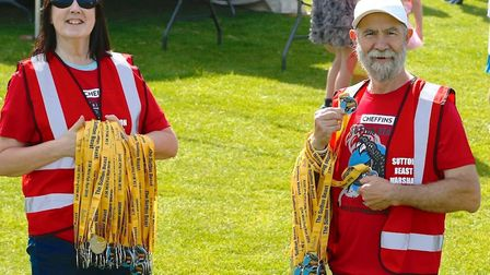 Organisers hold runners' medals. Picture: IAN STACEY PHOTOGRAPHER
