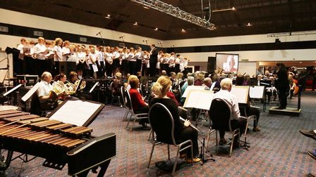 Ely composer James Olsen joined forces with a symphony orchestra to commemorate the 75th anniversary