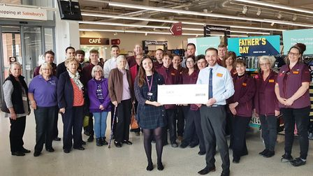 The cheque presentation at Sainsbury's in Ely after £3,000 was raised for the East Anglian Children'