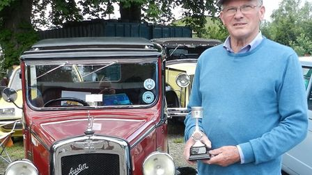 Mr Rayment with his winning Austin Seven. Picture: KEN WOODS