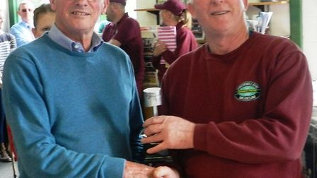Mr Rayment is presented with his trophy by chairman of Prickwillow Museum, Peter White. Picture: KEN