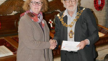 Donation towards Bomber Command archive project thanks to Ely team. Picture: MIKE ROUSE