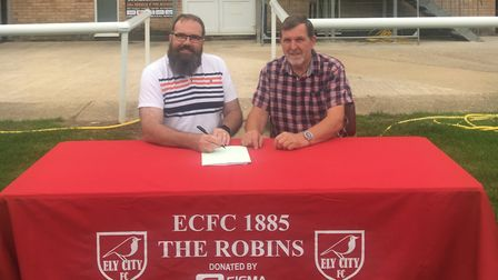 Youth chairman Steve Wickens (left) and chairman Robert Button (right) sign the new Ely City Footbal