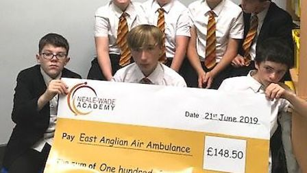 Pupils from Neale-Wade Academy raised nearly £150 for the East Anglian Air Ambulance. Picture: STEPH
