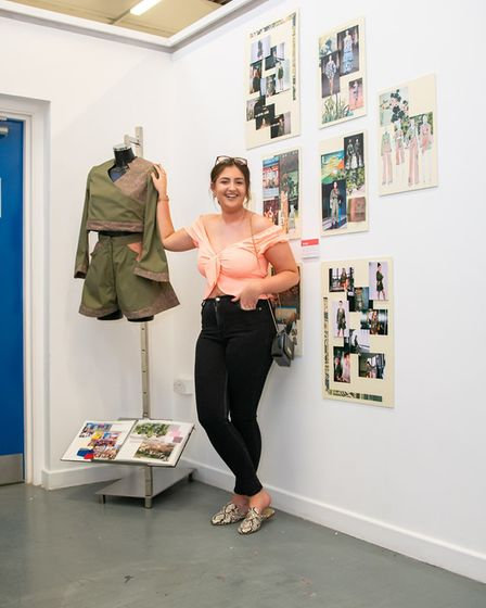 Wisbech art and design student Zoe Akred with her artwork at the opening of the College of West Angl