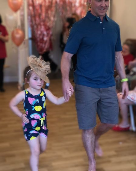 Staff and family members take to the catwalk at Aria Court's inaugural fashion show. Picture: HOLLY