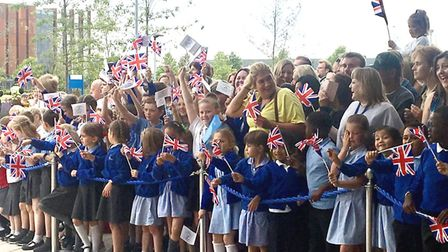 Her Majesty The Queen arrives at the new Royal Papworth Hospital to crowds of excited children wavin