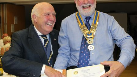 Outgoing Dunmow Rotary Club president with Willie Fraiser, the new president. Picture: CONTRIBUTED