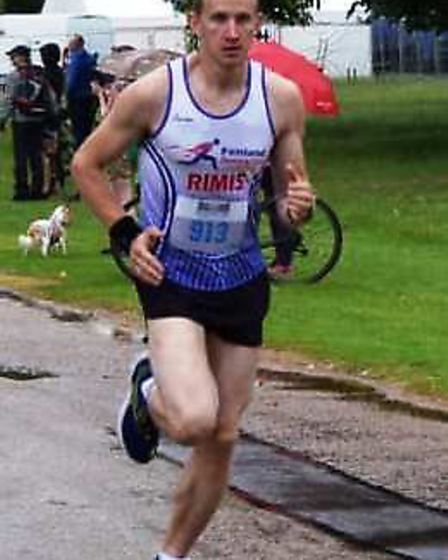 Rimvdas Muduras on his way to victory at the Holkham 10k. Picture: FENLAND RUNNING CLUB