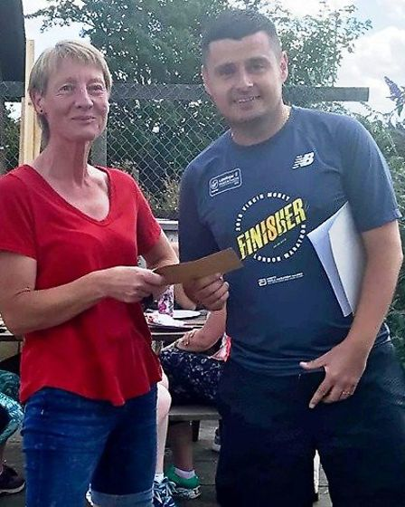Jac Richards receives her prize following the Whitemoor five-miler. Picture: FENLAND RUNNING CLUB
