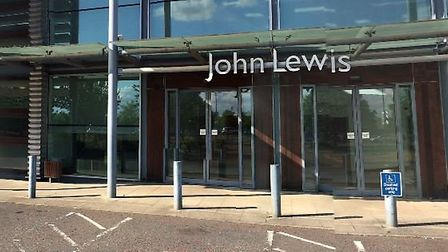 John Lewis warehouse manager Ian Bloomquest, of High Barns, Ely, was caught on CCTV loading two tele