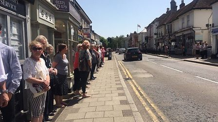 More than 150 people lined High Street in Dunmow to pay their respects to Nigel May. Picture: CONTRI