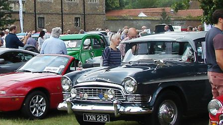 Motor enthusiasts taking a glimpse at the vintage vehicles on display at the Cambridge and District