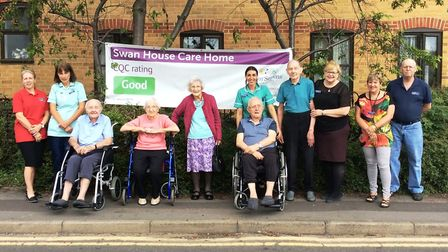 Staff and residents at Swan House care home in Chatteris celebrating another 'good' rating from The