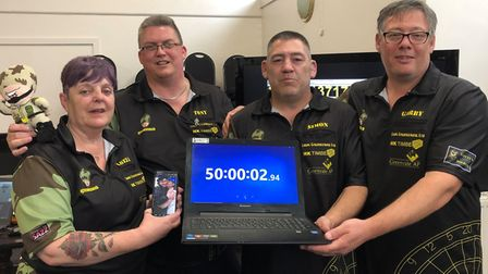 Tony Barnes and his team showcasing their world record time after their darts marathon. Picture: TON
