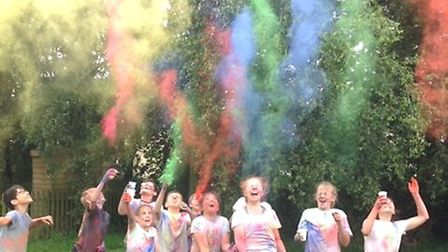 Children at Millfield Primary School take part in a Colour Run to raise funds for their teacher's ch