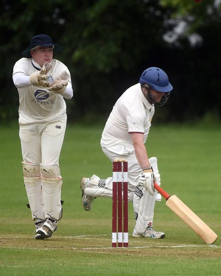 Wilburton wicket-keeper John Falconer and City of Ely batsman Tom Beaumont in action last Saturday.