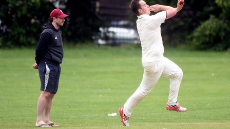 Matthew Morton bowling for Wilburton as they faced City of Ely. Picture: IAN CARTER