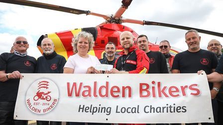 Karen Foreman (a stalwart tea lady for the mothly meetings) presents a cheque for £781.40 to HEMS Do