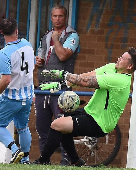 Chatteris Town goalkeeper, Lea Jordan, produces a low save to deny Histon. Picture: ADRIAN MORTON