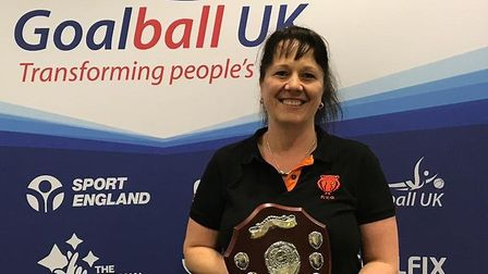 Emma Evans from Fen Tigers Goalball Club with Goalball UK's Keith Lound Memorial Award. Picture: OLI