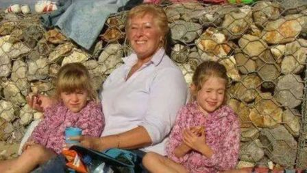 Sophie and her sister on a carefree day at the beach with their grandmother who was later to die in